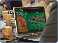 Playing roulette online game on laptop